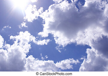 sunshine throught the clouds - blue sky and clouds with...