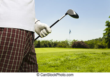 Golf club: golfer moving to the next hole