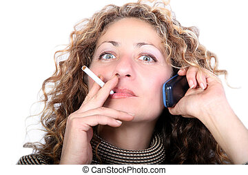 Smoking - Digital photo of a woman talking at the phone and...
