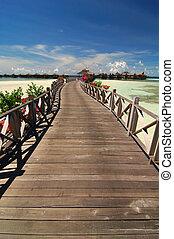 Tropical resort with wooden bridge