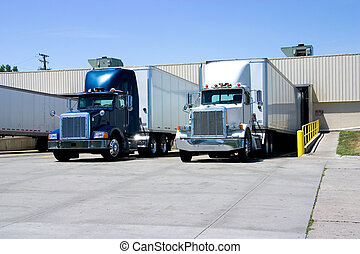 Trucks Loading - This is a picture of 18 wheeler semi trucks...