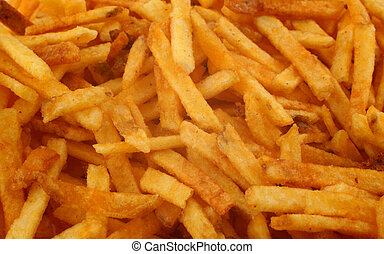 French fries background - close-up of fresh delicious French...
