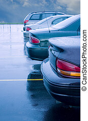 Rainy Parking Lot - cars lined up in a rainy parking lot
