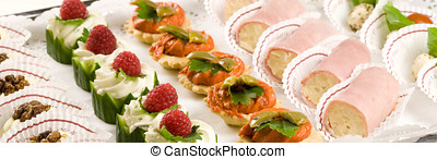 Party snacks - Nicely decorated party snacks served on a...