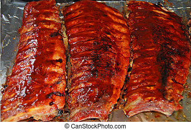 barbeque back ribs - pork back ribs on bar-b-q
