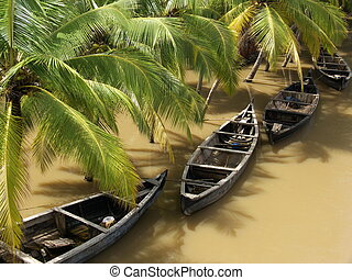 rainy kerala - boats on a river in kerala, south india,...