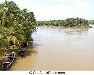 rainy kerala - boats on a river in kerala, south india,...
