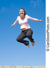girl jumps - the girl jumps with sky at background