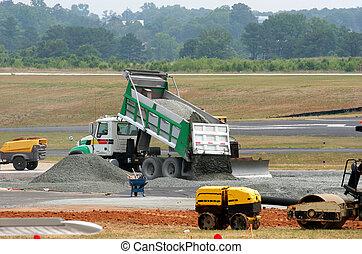Dumping Gravel - Dump truck dumping gravel on an airport...