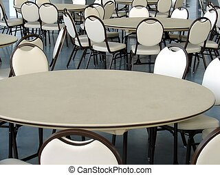 Empty Cafeteria - Tables and chairs in an otherwise empty...