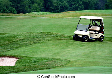 Golf cart on golf course - an image of a Golf cart on golf...