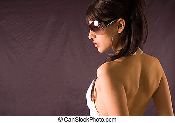 Over shoulder - Young beauty woman looks over her shoulder