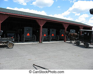 mennonite transportation - mennonite buggys parked while at...