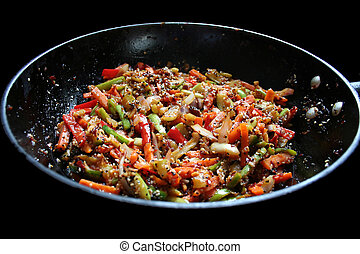 Stir-fried vegetables - A wok of stir-fried asian vegetables
