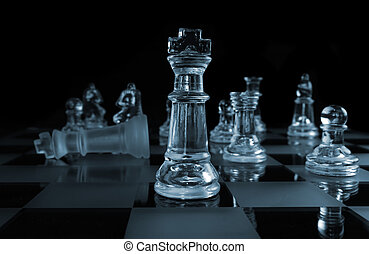 Triumph - Glass Chess Pieces on a Frosted Glass Chess Board...