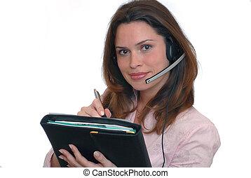 Beautiful secretary - Secretaty with hands free headset over...