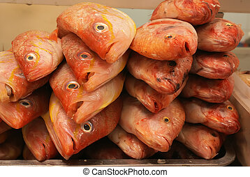 tilapia - A pile of fresh tilapia in the marketplace