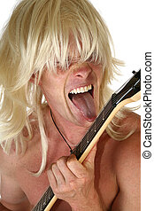 Rock Guitarist - Blond man licking electric guitar over...