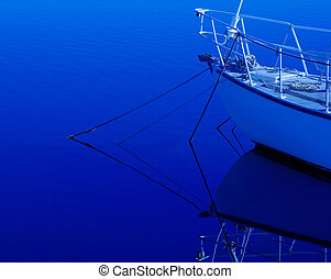 Yacht reflections - The bow of a Yacht and its reflection in...