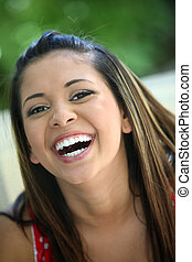 Happy young girl - Portrait of a young mexican girl laughing
