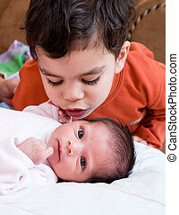 Hey little sister - A young boy talking to his newborn...