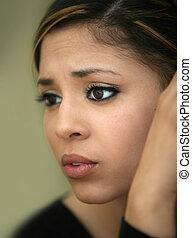 Worried teen girl - Close-up portrait of a worried teen girl
