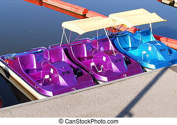 paddle boats - colorful paddle boats for rent at the local...