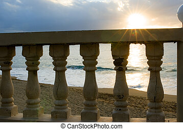 sunset over the rail with flare - sunset over the beach