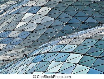 Glass building roof - details of the roofs of Tarasy mall in...