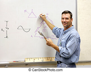 Teacher At the Board - A handsome teacher drawing a...