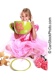 Tea party - Cute little girl having a tea party