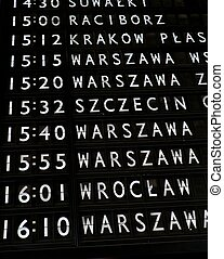 Train departures board in Warsaw main train station
