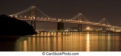Bay Bridge at night with reflection in the water