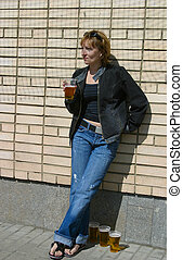 Glasses with beer - The girl with plastic glasses with beer
