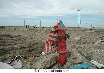 America\\\'s Disaster - A torn and battered American flag...