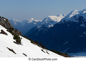 Misty Fjords National mon - Mountain range with glaciers in...