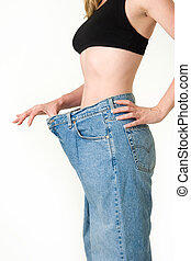 Last years jeans - Woman demonstrating weight loss by...