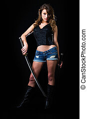 Sexy samurai - Attractive sexy woman in shorts holding a...