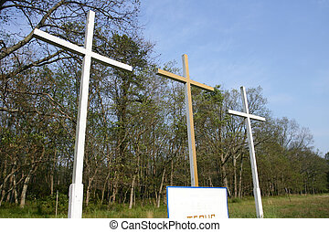 Crosses 3 - 3 crosses with a sign at the bottom that says...