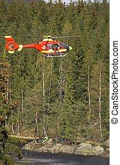 Rescue Chopper Hover - A red Norwegian Air Ambulance...
