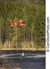 Rescue Chopper Lift - A red Norwegian Air Ambulance...