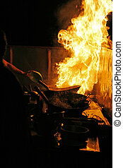 Cooking with fire - Night scene at an outdoor restaurant in...