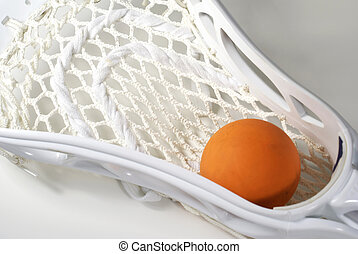 Lacrosse Head and Ball - a white lacrosse stick head and an...