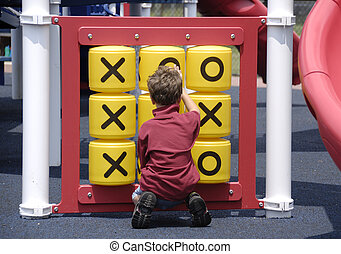 Child at Play - Photo of a Child Playing in a Park - Tic Tac...