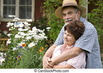 romantic senior couple - Happy elderly couple embracing...