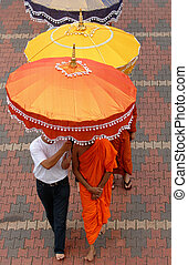 Buddhist Monks - Buddhist monks under umbrella