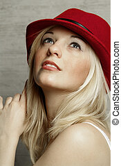 blond woman - a blond women with a red hat
