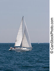 Sailboat with full sails