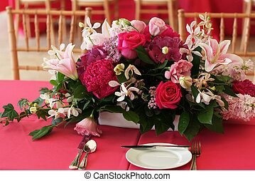 Center piece - A rose centerpiece is decorating the table...