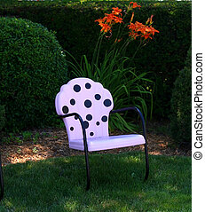 Polka dot chair - A white chair with polka dots is in a...